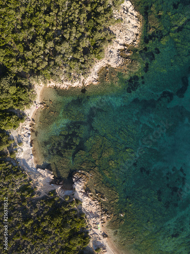 Foto op Plexiglas Kust View from above, aerial view of a rocky coast bathed by an emerald and transparent Mediterranean sea, Costa Smeralda, Sardinia, Italy