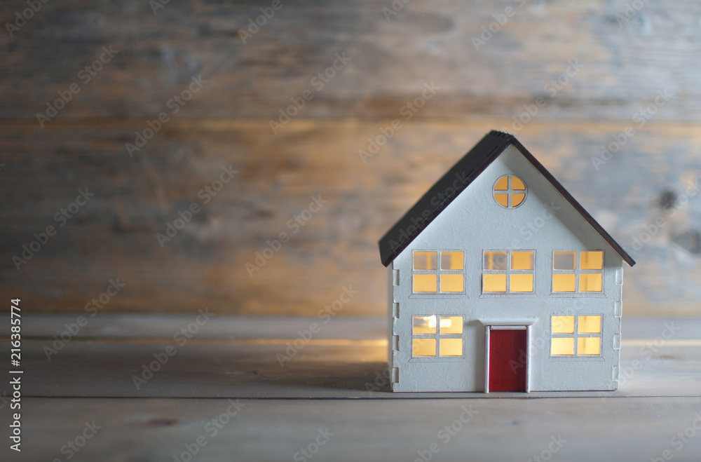 Fototapety, obrazy: Miniature house over a wooden background