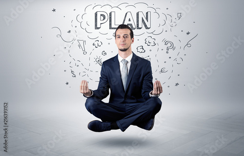 Canvastavla Businessman sitting in yoga position and meditates with doodle concept