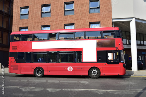 Poster Londen rode bus Double Decker red bus is running on road in London