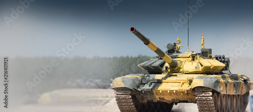 Staande foto Cartoon cars Military or army tank ready to attack and moving over a deserted battle field terrain. a lot of dust. copyspace