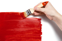 Hand Painting Using A Thick Red Brush, Isolated On White Background