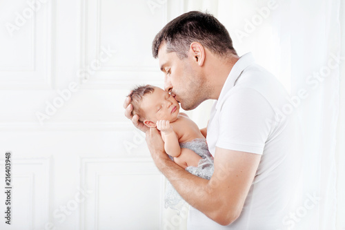 Father holding his newborn baby in  hands Canvas Print