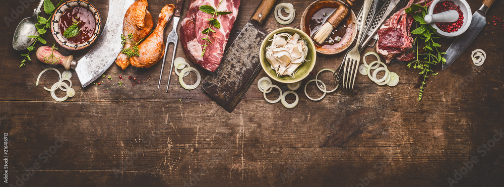 Fototapety, obrazy: Various grill an bbq meats on rustic wooden background with aged kitchen and butcher tools, herbs, spices, seasoning and sauce, top view, border