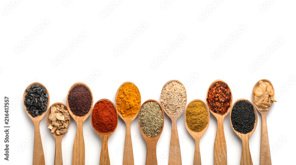 Fototapety, obrazy: Composition with different aromatic spices in wooden spoons on white background