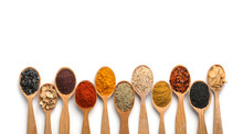 Composition With Different Aromatic Spices In Wooden Spoons On White Background