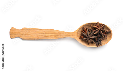 Wooden spoon with anise stars on white background Canvas Print
