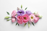 Flat lay composition with beautiful Eustoma flowers on light background