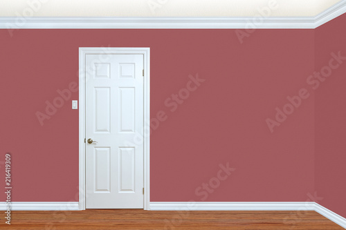 Photo Bedroom wall and corner with door, baseboard and crown molding.