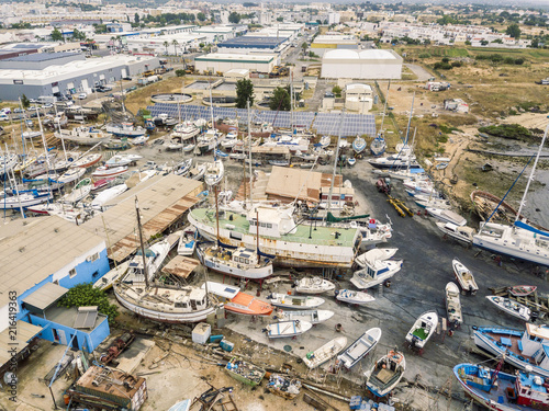 Foto op Aluminium Poort Aerial view of sewage treatment plant and shipyard in Olhao, Algarve, Portugal