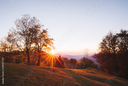 Stickers pour portes Orange eclat Autumn landscape with a haystack in a mountain village. Countryside view