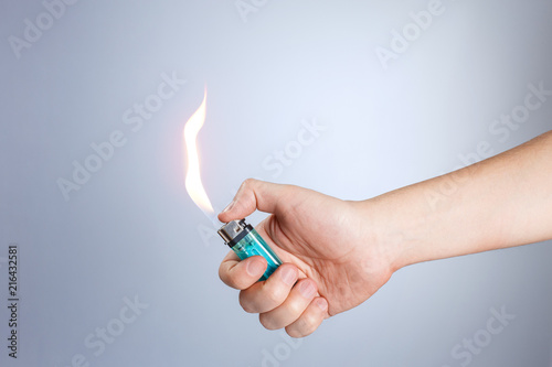 Hand burning a lighter on white background Canvas Print