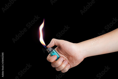 Hand burning a lighter on black background Wallpaper Mural