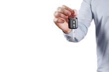 Male Hand Holding Car Key, Isolated On White Background