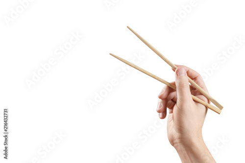 Male hand holding chopsticks, isolated on white background Wallpaper Mural