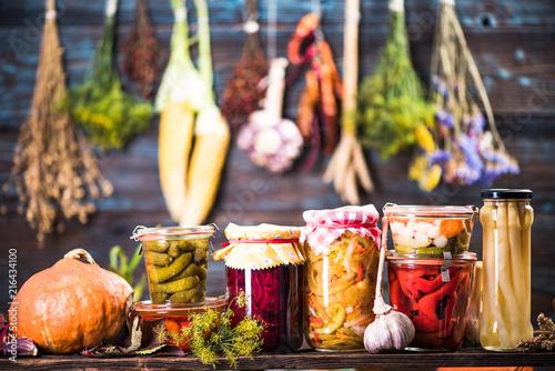 Pickled Marinated Fermented vegetables on shelves Tableau sur Toile