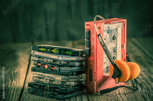 Antique cassette tape with headphones and walkman - 216438530
