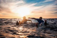 Sun Surfer. A Man Is Walking W...