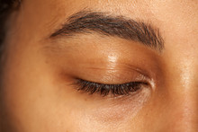 Natural Eyebrow And Closed Eye Without Makeup Of Dark Skinned Female
