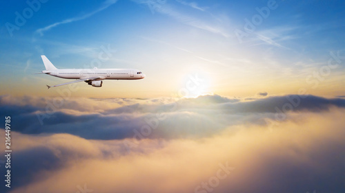 Foto op Aluminium Vliegtuig Detail of commercial airplane flying above clouds