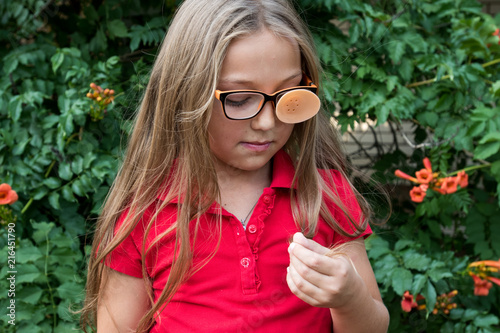 .Child in glasses with Occluder. Ortopad Girls Eye Patches nozzle for glasses fo Canvas-taulu