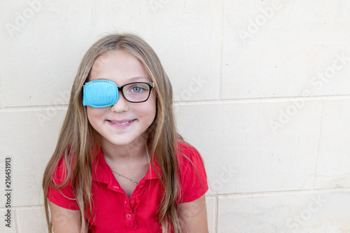 Cuadros en Lienzo .Child in glasses with Occluder. Ortopad Girls Eye Patches nozzle for glasses fo