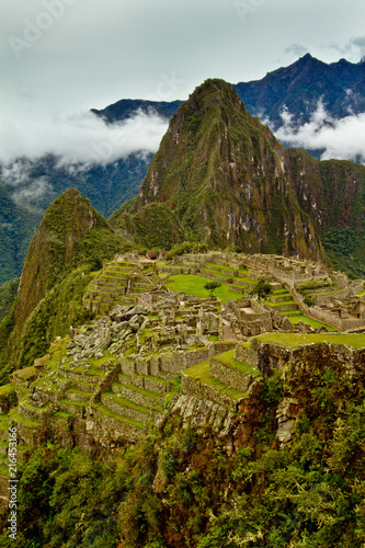 Fotografie, Obraz  Vertical Image of Machu Picchu with Hauyna Picchu looming- an explorers and adve