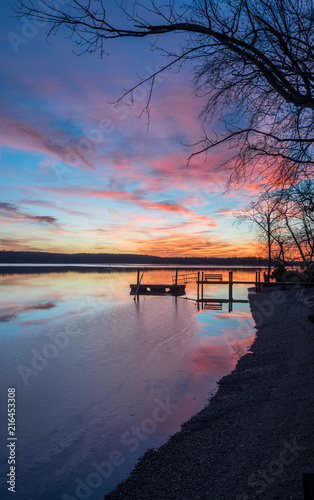 Fotobehang Pier Sunset Over Dock with Ice on the Water