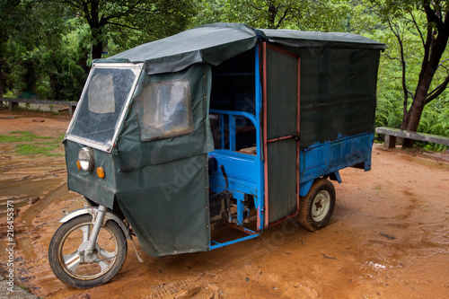 Fotografie, Obraz  China Mini Car 3-Wheel Passenger Motorcycle - Chinese Commercial Tricycle for passengers, auto Rickshaw