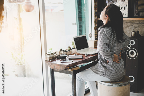 Obraz Businesswoman suffering from pain of lower back - fototapety do salonu