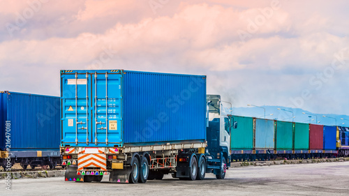 Türaufkleber Eisenbahnschienen Freight trailer with cargo container and freight train with cargo containers background, import export business logistic.