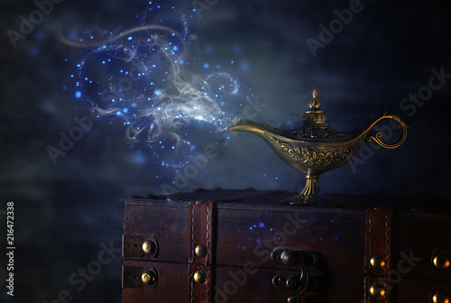 Image of magical mysterious aladdin lamp with glitter sparkle smoke over black background Wallpaper Mural