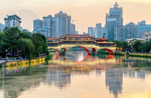 Fototapeta Nine hole bridge and skyscraper in chuengdu,china obraz
