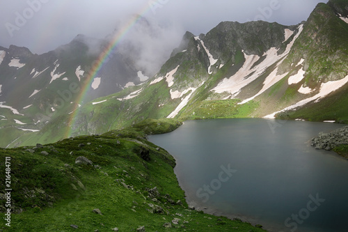 Poster Bergen Beautiful view of Lake Zaggedan in the Caucasus Mountains in Russia, rainbow after rain