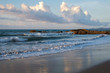 beautiful view of waves hits beach during sunset. soft focus due to slow shutter.