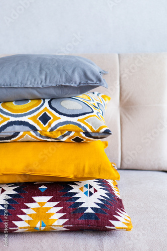Multi Colored Pillows On A Beige Fabric