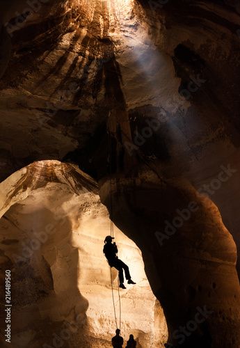 Silhouette of training alpinist in Luzit caves Wallpaper Mural