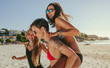 Woman friends sunbathing and enjoying on beach