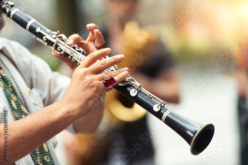 Foto Detail of a street musician playing the clarinet
