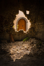 An Old Wooden Arched Door In S...