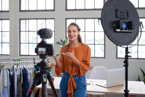 Fotomural Social media entrepreneur recording daily vlog in studio