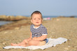 Baby playing on the sandy beach
