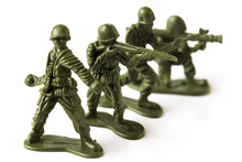 Four Green Toy Plastic Soldiers, Isolated On White Background