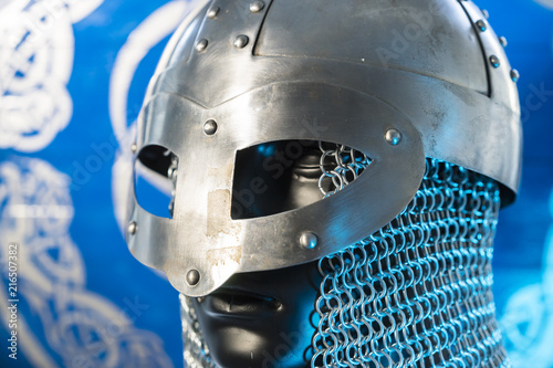 Fotografia  berserker, helmet of viking warrior with mail on coat of arms with drawings and