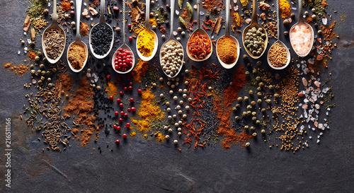 Printed kitchen splashbacks Spices Spices on black graphite board