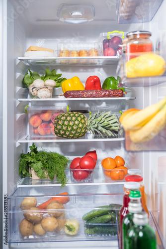 Open fridge full of fresh groceries