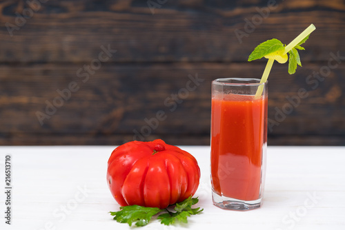 Fotobehang Sap Organic tomato with glass of vegetable juice