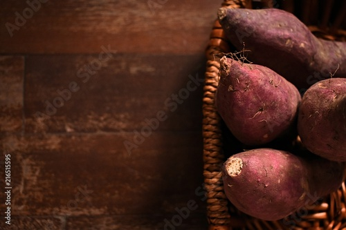 Sweet potato in the basket , wooden brown table
