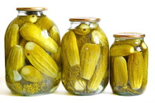 Three Closed Glass Jar Of Different Volume With Marinated Green Pickles In Brine And Spices: Garlic, Dill, Peas Black Hot Pepper. Isolated. White Background