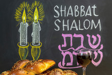 Jewish Greetings Shabbat Shalom And Candles Painted On A Chalkboard. May You Dwell In Completeness On This Seventh Day. Challah And Glass Of Wine.
